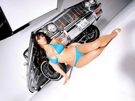 Lrmp_0802_07_z+1964_chevrolet_impala_ss_convertible+jaime_in_front